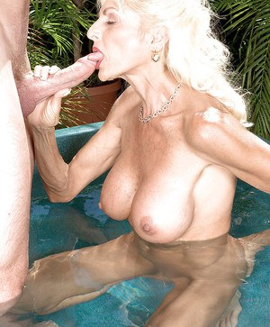 Sexy mature blonde with amazing boobs Sasha Samuels fucking hard in the pool