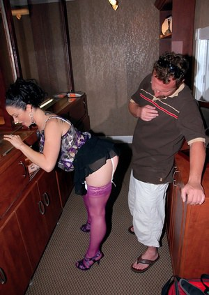 Dark-haired busty milf in stockings takes cock from behind