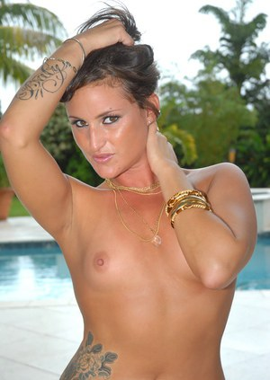 Tattooed milf in pool panties and out of them: outdoor shoot