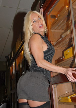 Milf porn star with gigantic tits spreads legs in stockings