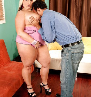 Lovely BBW fatty Porsche Dali shows her big tits in very hot pink lingerie.