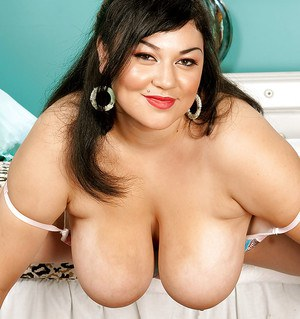 Big breasted BBW fatty Julia Juggs shows off her big breasts and sexy chubby legs in white panties.
