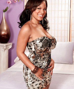 Very elegant BBW lady Natasha Dulce shopws off her big ebony jugs in very slutty dress and high heels.