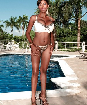 Valory Irene teases us with her divine body as she poses in sexy bikini by the pool and shows her big tits.
