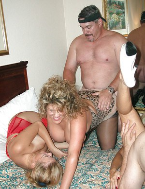 Two horny and classy mature wenches joined young married couple for a wild and hard groupsex session.