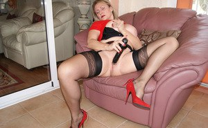 Very classy blonde old lady takes her panties off, spreads her legs and toys her seasoned cunt.