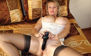 Old mature wench looks very seductive as she masturbates her pussy wearing sexy lingerie and stockings.