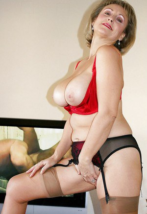 Blonde mature fatty goes wild in sexy lingerie and starts masturbating.