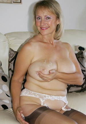 Smiling mature vixen puts on some expensive lingerie and teases us with her hot body.