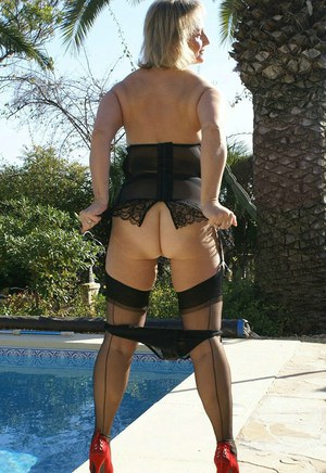 Beautiful mature fatty puts on sexy red black corset and nylon stockings as she teases outdoors by the pool.