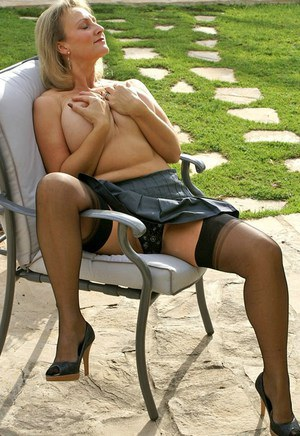 Very classy and sexy blonde mature fatty shows off her hot ass in sexy mini skirt and nylon stockings.