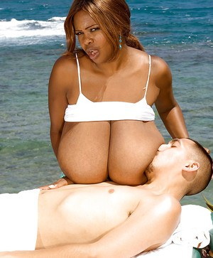 Huge melloned ebony lady loves showing off her breasts outdoors by the beach as she makes out and shags with a hung stud.