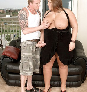 Fabulous Karlee Adams takes off her black dress and shags with her tattooed young hunk.