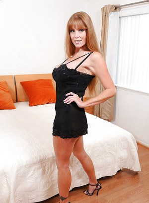 Mature hottie Darla Crane gets ready for her man in the bedroom so she puts on her finest black lingerie and high heels on.