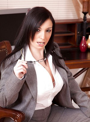 Michelle Bond is brunette businesswoman and MILF who loves to strips in her office.
