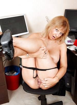 Mature lady in glasses playing with her round boobs and panties in the office