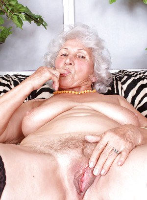 Fat granny stripping from black lingerie and caressing moist pussy