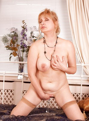 Fat mom in nylon stockings revealing big tits and fondling her tempting twat