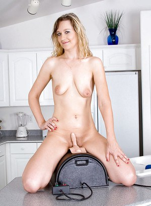 Luscious mom Nicole Logan exposing boobs before riding the sybian