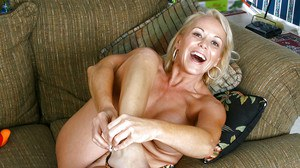 Busty mature blonde in silk nighty stripping and toying her hot pussy