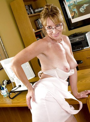Mature office secretary Samantha Stone stripping to white stockings