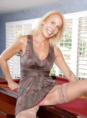 Hot mature Erica Lauren revealing hooters and pussy on the pool table