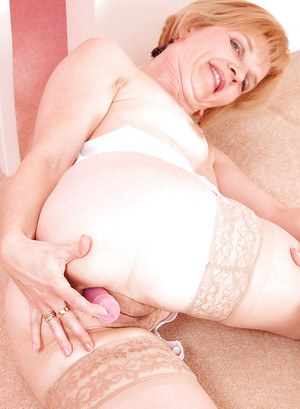 Luscious mature blonde stripping to stockings and revealing big ass