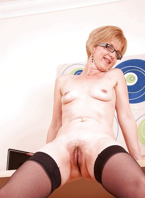 Mature secretary in glasses spreading her hairy twat on the table