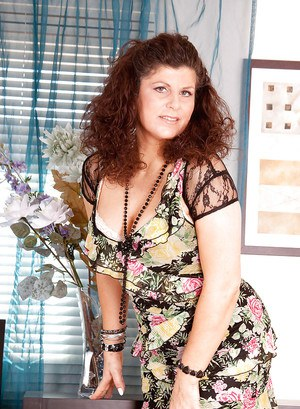 Fat mature seductress in sheer stockings showing off her old pussy