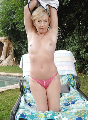 Mature blondie stripping from pink panties and flashing outdoor