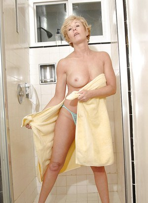 Cute mature babe showing off shapely tits and butt in the shower