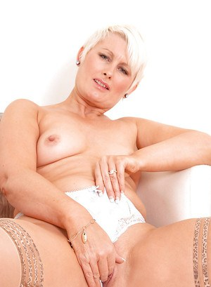 Mature bbw Sally Taylor stripping to stockings and showing off pussy