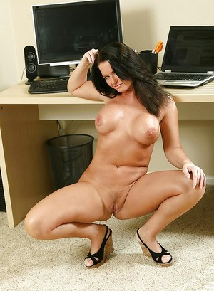 Mature fatty Maya Divine shows her big tits at her office.