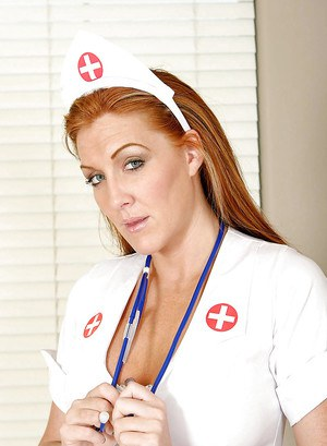 Hot MILF lady Morgan Reigns in nurse uniform rides fucking machine.