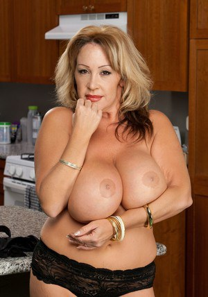 Mature fatty with big tits Kandi Cox posing in sexy lingerie.