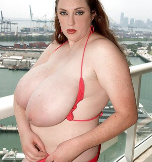 Brunette fatty Alice Webb shows her big tits outdoor.