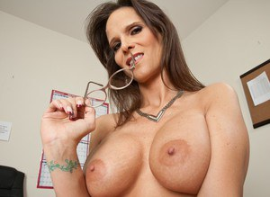 Mature teacher with glasses Syren De Mer poses in expensive lingerie.