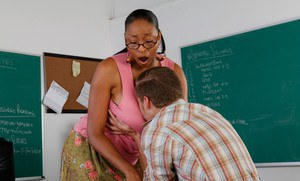 Busty ebony MILF Carmen Hayes in reality sex teacher porn scene.