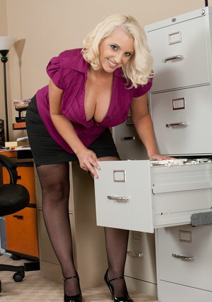 Sexy office mom Mandy Sweet shows her huge booty and boobies