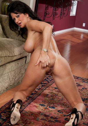 Raquel Devine shows her big ass and tits in high heels shoot