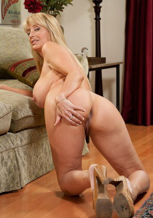 Mature doll Olivia Parrish showing you her big juggs and holes