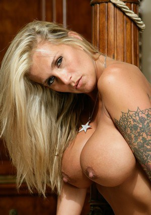 Tattooed milf Farrah shows the huge boobs she is sporting