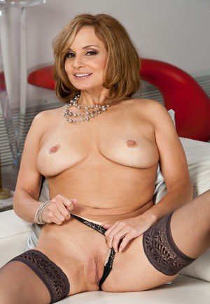 Mature Rebecca Bardoux takes her lingerie off nice and slow