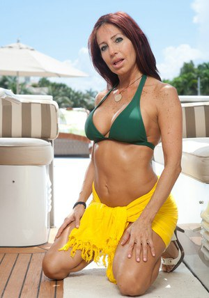 Mature model Tara Holiday showing you her ever-perfect body