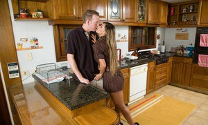 Latin wife Esperanza Gomez gets her big tits oiled up for kitchen sex