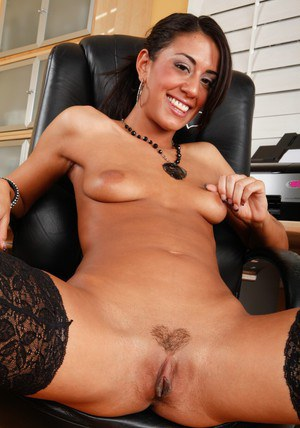 Slim beauty Lyla Storm showing off her sexy legs in black stockings