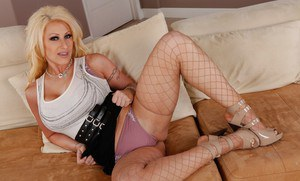 Tempting blonde Candy Manson masturbating in fence net stockings