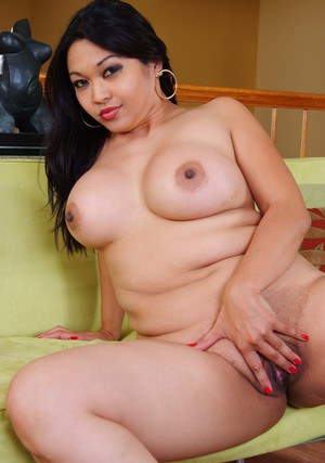Fat asian wife Mika Tan taking off panties to rub wet brown pussy