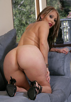 Mature latina Sasha Sky spreading her yummy booty on the couch