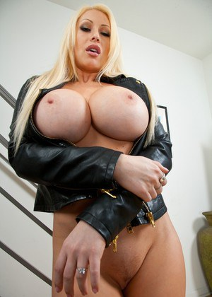 Busty wife Candy Manson stripping from leather biker suit and lingerie